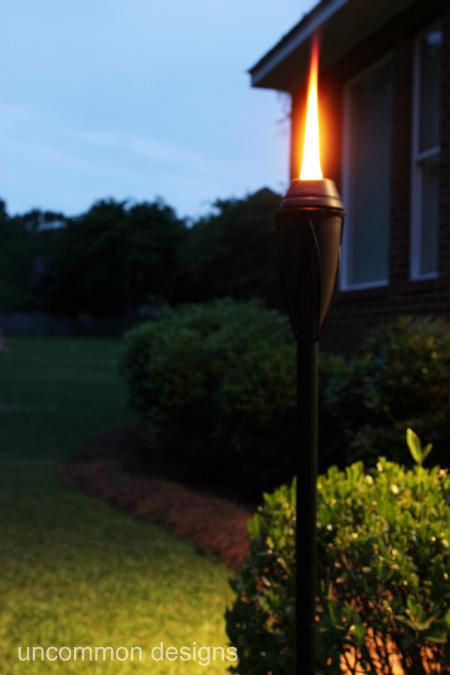 tiki torch at night
