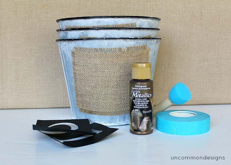 Burlap stenciled buckets via Uncommon Designs.
