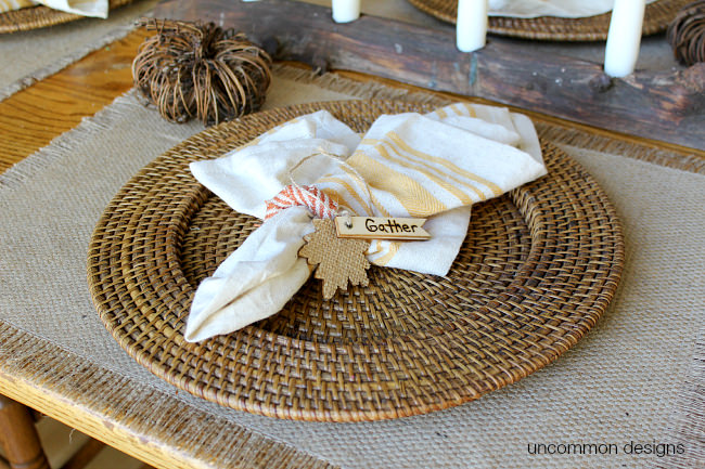 DIY Thanksgiving Napkin Rings for a beautiful fall or thanksgiving table. Burn words into wooden tags for a personalized touch. A simple way to add a fun touch to your fall decorations via Uncommon Designs