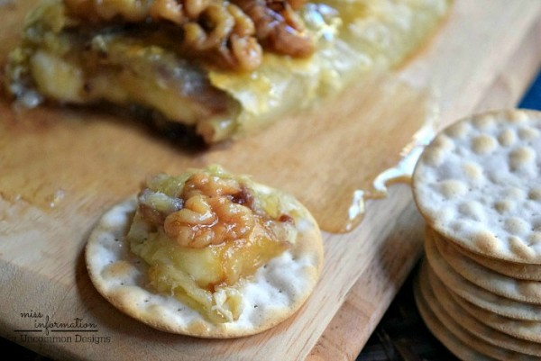 The perfect Holiday Appetizer!  Raspberry Walnut Baked Brie via Uncommon Designs