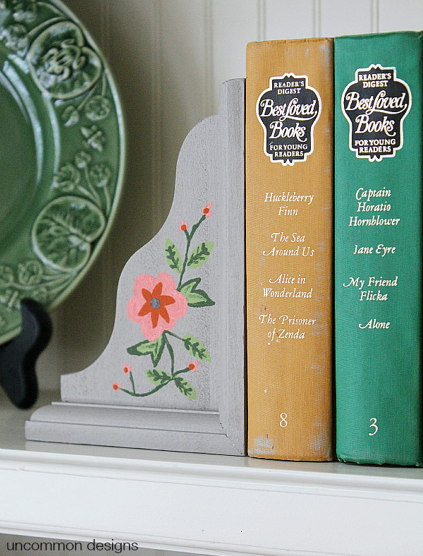 Create organization and custom home decor! These Painted Wooden Corbel Bookends will be the stars of your shelf via Uncommon Designs #decoartprojects