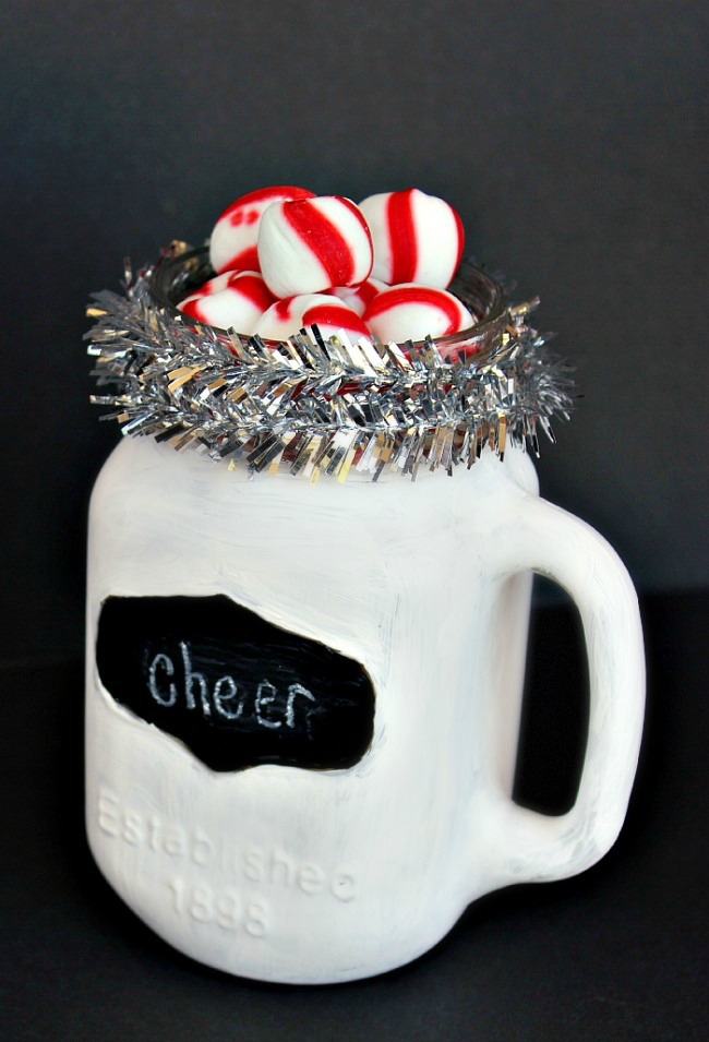 Paint a mason jar mug and fill it with goodies as a quick gift for the holidays! | Uncommon Designs