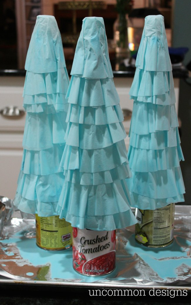 Coffee Filter Christmas Trees are the easiest Christmas decoration you will make this year! Grab some coffee filters and a little paint... the perfect kids holiday craft! | Uncommon Designs
