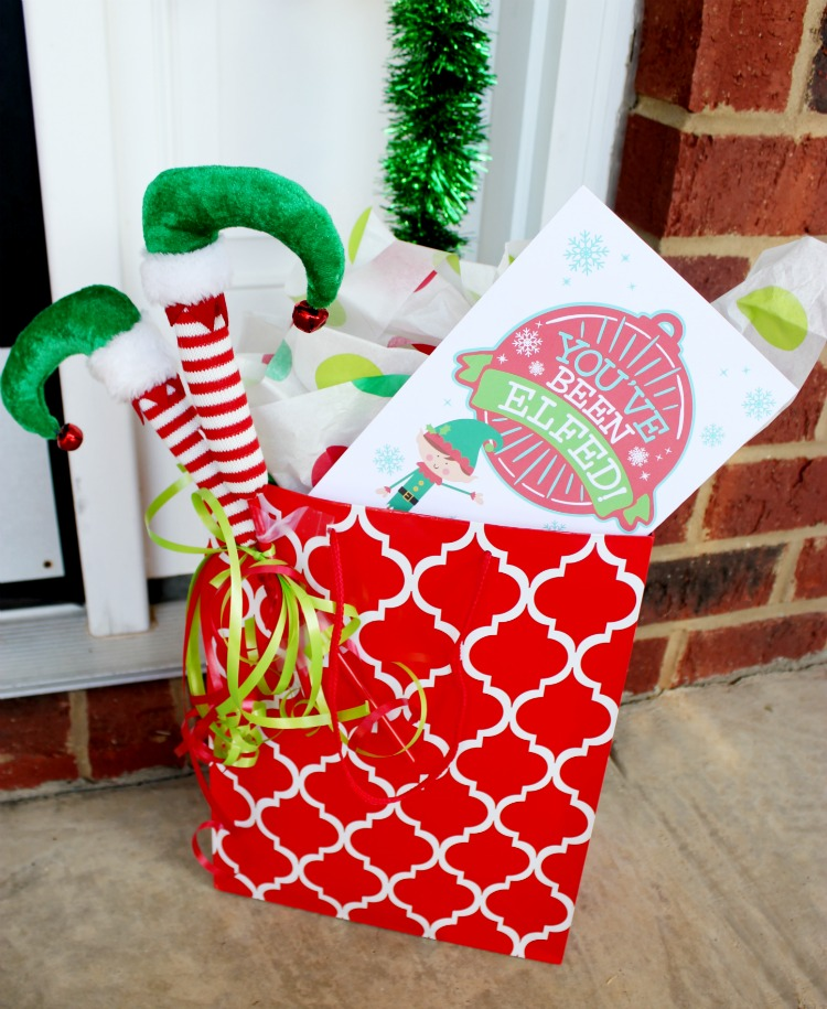 Enjoy this fun new tradition at work or in your  neighborhood. Elfing your Neighbor is so much fun to do and we are sharing inspiring ideas and Free Printables! Find more at https://uncommondesignsonline.com #Christmas #HolidayTraditions #FamilyFun