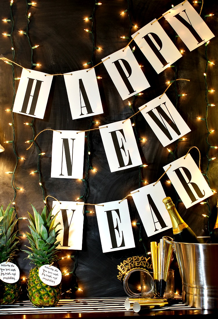 Ring in the new year with this simple Happy New Year free printable banner. It will match any decor and it is so easy to print and hang! See it at https://uncommondesignsonline.com #NewYearsEve #Free Printables