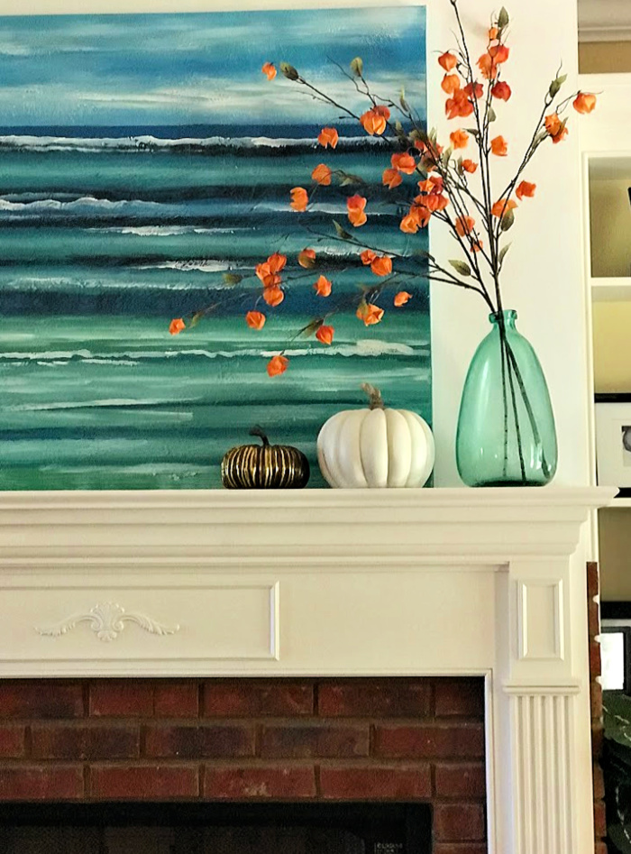 A coastal fall mantel. These simple fall decorations and a little paint made this project crazy easy!